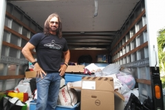 Shirt Off My Back (Pic Of Tom with Logo Shirt in box truck